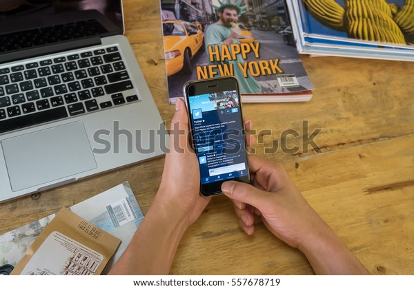 """CHIANGMAI, THAILAND - JAN 16,2017 : iphone 6s open Twitter application with night mode ,Twitter is an online social networking and microblogging service that enables users to send and read """"tweets"""""""