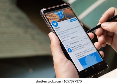 CHIANGMAI, THAILAND -JAN 5,2018:Men hand holding Samsung galaxy note8 smartphone and using Twitter application,Twitter is an online social networking.