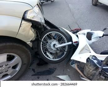 CHIANGMAI, THAILAND - JANUARY 10, 2013: Crash Accident NISSAN FRONTIER NAVARA Pickup Truck with HONDA Motorcycle at roadside in Chiangmai, Northern Thailand.