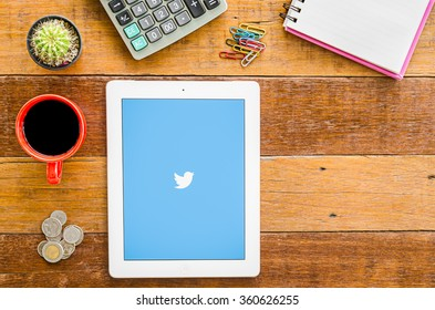 """CHIANGMAI, THAILAND -JANUARY 10,2016:IPad 4 open Twitter application.Twitter is an online social networking and microblogging service that enables users to send and read """"tweets"""""""