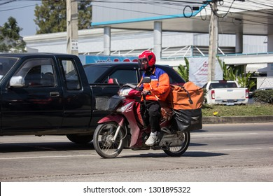 Chiangmai, Thailand - January 14 2019:  Postman and Motercycle of Thailand Post. Photo at road no.121 about 8 km from downtown Chiangmai, thailand.