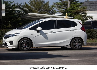 Chiangmai, Thailand - January 14 2019:  Private city Car Honda Jazz. Five door hatchback automobile. Photo at road no.121 about 8 km from downtown Chiangmai thailand.