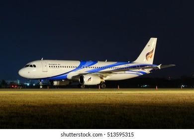 Chiangmai, Thailand. January 23, 2014. Bangkok Airways Airbus A320 Park on Parking Stand at Chiangmai International Airport at Night.
