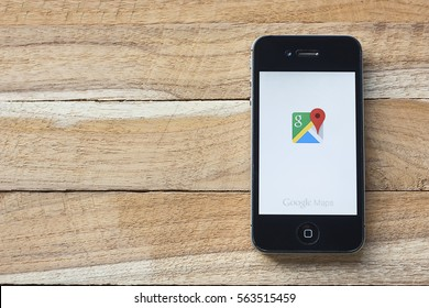 CHIANGMAI, Thailand - January 25,2017: iPhone 4s with Google Maps application laying on desk. Google Maps is a desktop web mapping service developed by Google.