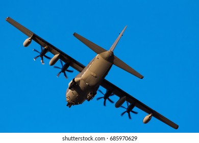 Chiangmai, Thailand. January 31, 2016. MC-130J United States Air Force (USAF) Flying Low Pass Over Chiangmai International Airport with Blue Sky.