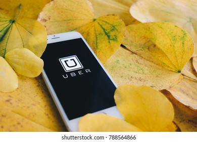 Chiangmai, Thailand - January 4, 2017 : iPhone6s and Uber app on yellow leaf background, Uber is smartphone app - based transportation network.