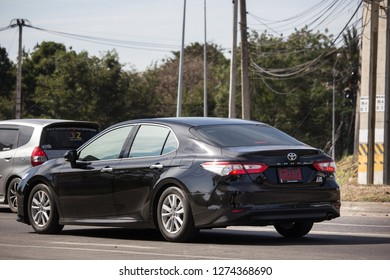 Chiangmai, Thailand - January 4 2019: Private car New Toyota Camry. On road no.1001 8 km from Chiangmai Business Area.
