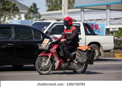 Chiangmai, Thailand - January 4 2019:  Postman and Motercycle of Thailand Post. Photo at road no.121 about 8 km from downtown Chiangmai, thailand.