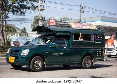 Chiangmai, Thailand - January 4 2019:  Green Pickup truck taxi Chiangmai, Isuzu Pickup truck.  On road no.1001, 8 km from Chiangmai Business Area.