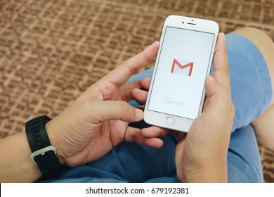 Chiangmai, Thailand - July 17, 2017 : hand holding screen short of Gmail app showing on iPhone6. Gmail is free e-mail service provided by google