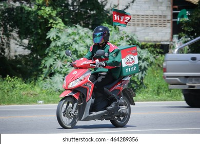 CHIANGMAI, THAILAND -JULY 27 2016:  Delivery service man ride a Motercycle of The Pizza Company.  On road no.1001, 8 km from Chiangmai Business Area.