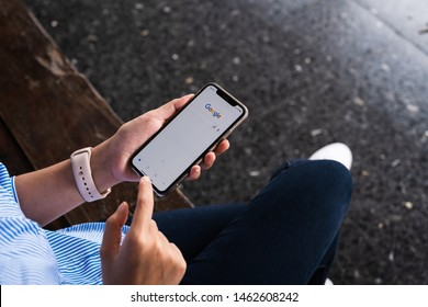 CHIANGMAI, Thailand : JULY 27, 2019 : A woman is typing on Google search engine from a laptop. Google is the biggest Internet search engine in the world.