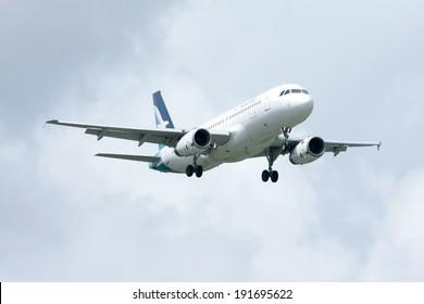 CHIANGMAI, THAILAND - JULY  28 2010: 9V-SLC  Airbus A320-200 of Silkair, Landing to Chiangmai airport from Singapore.