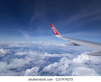 ChiangMai Thailand- July 4 2018: AirAsia's airliner flying in the sky in Thailand.