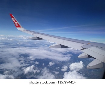 ChiangMai Thailand- July 4 2018: AirAsia's airliner flying in the sky in Thailand