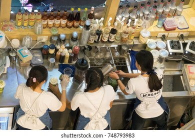 Chiangmai, Thailand - July 8, 2017: A part time young student working at coffee shop on school holiday.