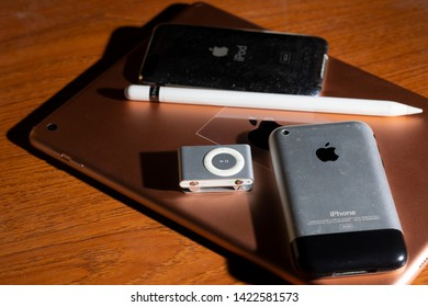 CHIANGMAI , THAILAND - JUN 13 2019: iPad and Apple pencil with iPhone 2G, iPod shuffle and iPod 2Gen on wooden.