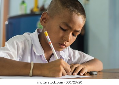 CHIANGMAI, THAILAND - JUN 18: Student little asian boy, countryside in Thailand on June 18, 2015 at School in CHIANGMAI, Thailand