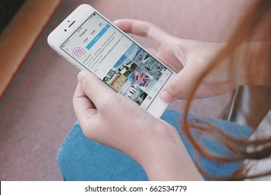 CHIANGMAI, THAILAND - June 19, 2017 : hand holding Apple iPhone 6 with Instagram application on the screen. Instagram is photo sharing app for smartphones.