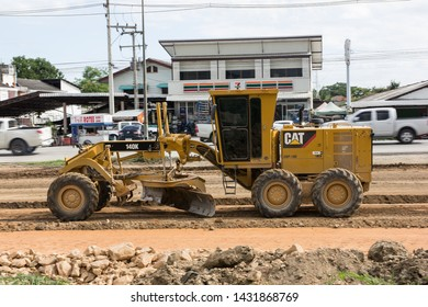 Chiangmai, Thailand - June 21 2019: Cat 140k motor grader on Construction site. Photo of new road no.121 outside ring road of chiangmai city.