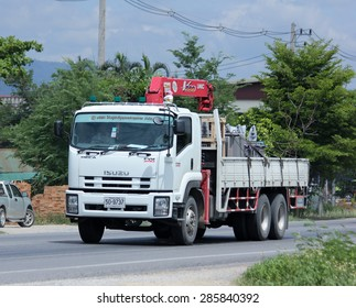 CHIANGMAI , THAILAND -JUNE 3 2015:  Truck with crane. Photo at road no.121 about 8 km from downtown Chiangmai, thailand.
