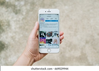 Chiangmai, Thailand - June 30, 2017: hand holding Apple iPhone6 with Instagram application on the screen. Instagram is photo - sharing app for smartphones.