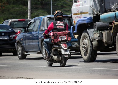 Chiangmai, Thailand - June 4 2019: Delivery service man ride a Motercycle of KFC. On road no.1001, 8 km from Chiangmai city.