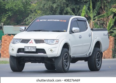 CHIANGMAI, THAILAND -MARCH 12 2016:   Private car, Mitsubishi Triton Plus. Photo at road no 121 about 8 km from downtown Chiangmai, thailand.