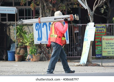 CHIANGMAI, THAILAND -MARCH 13 2016:  Survey man of  Department of Highways. Photo at road no 121 about 8 km from downtown Chiangmai, thailand.