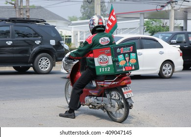 CHIANGMAI, THAILAND -MARCH 14 2016:  Delivery service man ride a Motercycle of The Pizza Company. On road no.1001, 8 km from Chiangmai city.