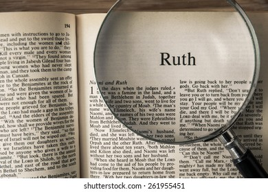 """CHIANGMAI, THAILAND, March 17,2015. Reading The New International Version of the Holy Bible on the book of """" ruth """" at home. March 17,2015"""