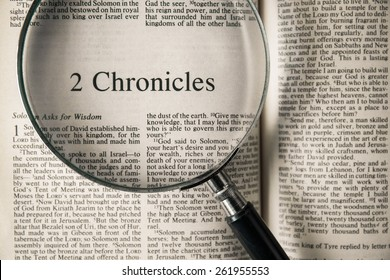 """CHIANGMAI, THAILAND, March 17,2015. Reading The New International Version of the Holy Bible on the book of """" chronicles """" at home. March 17,2015"""