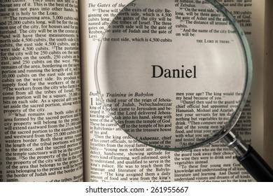 "CHIANGMAI, THAILAND, March 17,2015. Reading The New International Version of the Holy Bible on the book of "" daniel "" at home. March 17,2015"