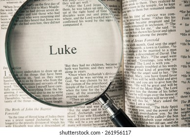 "CHIANGMAI, THAILAND, March 17,2015. Reading The New International Version of the Holy Bible on the book of "" luke "" at home. March 17,2015"