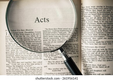 """CHIANGMAI, THAILAND, March 17,2015. Reading The New International Version of the Holy Bible on the book of """" acts """" at home. March 17,2015"""