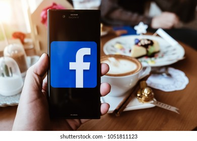Chiangmai, THAILAND - March 21, 2018: Facebook social media app logo on log-in, sign-up registration page on mobile app screen on sony experia xzs smart devices in business person's hand at work