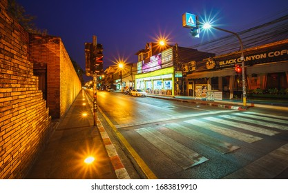 CHIANGMAI, THAILAND - MARCH 25, 2020 :  Coronavirus (COVID - 19) ,Scenery of THA PHAE GATE at the night of Chiang Mai after The government has ordered residents to stay in home from 20.00 of March 26