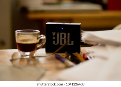 CHIANGMAI, THAILAND- March 3, 2018: The black portable mini speaker, JBL GO, on the working desk