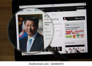 CHIANGMAI, THAILAND - March 31, 2015: Photo of Forbes article page about Xi Jinping on a ipad monitor screen through a magnifying glass.