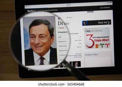 CHIANGMAI, THAILAND - March 31, 2015: Photo of Forbes article page about Mario Draghion a ipad monitor screen through a magnifying glass.