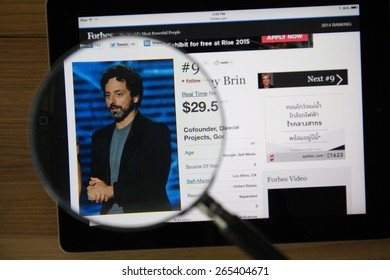 CHIANGMAI, THAILAND - March 31, 2015: Photo of Forbes article page about Sergey Brinon a ipad monitor screen through a magnifying glass.