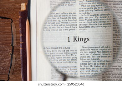 "CHIANGMAI, THAILAND, March 3,2015. Reading The New International Version of the Holy Bible on the page of "" 1 king "" at home. March 3,2015"