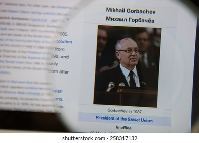 CHIANGMAI, THAILAND - March 5, 2015: Photo of Wikipedia article page of Mikhail Gorbachev on a ipad monitor screen through a magnifying glass.