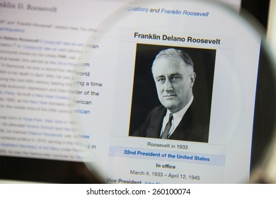 CHIANGMAI, THAILAND - March 5, 2015: Photo of Wikipedia article pageof Franklin D. Roosevelt on a ipad monitor screen through a magnifying glass.