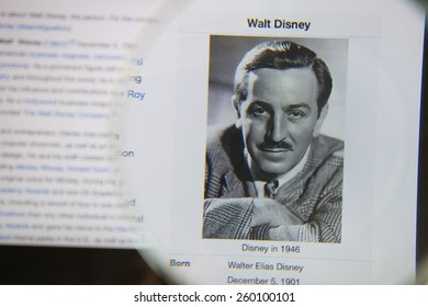 CHIANGMAI, THAILAND - March 5, 2015: Photo of Wikipedia article page about Walt Disney on a ipad monitor screen through a magnifying glass.