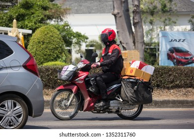 Chiangmai, Thailand - March 8 2019: Postman and Motercycle of Thailand Post. Photo at road no.121 about 8 km from downtown Chiangmai, thailand.