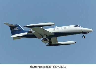 Chiangmai, Thailand. May 14, 2016. Bombardier Learjet 35A Reg. D-CGRC on Short Final for Landing at Chiangmai International Airport with Blue Sky.