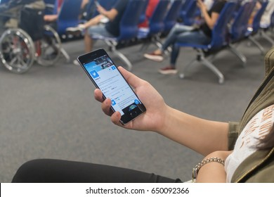 CHIANGMAI, THAILAND -MAY 25,2017:Women hand holding smartphone and using Twitter application,Twitter is an online social networking.