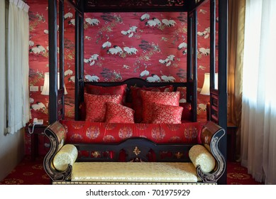 Chiangmai, Thailand - May 4, 2017 - Red decorated bed in Chinese style set for the bride and the groom in Thai cultural wedding ceremony