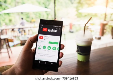 Chiangmai Thailand- Nov 13, 2017: Female hand holding a Sony xperia xzs mobile phone which displays the Youtube app on the touch screen.